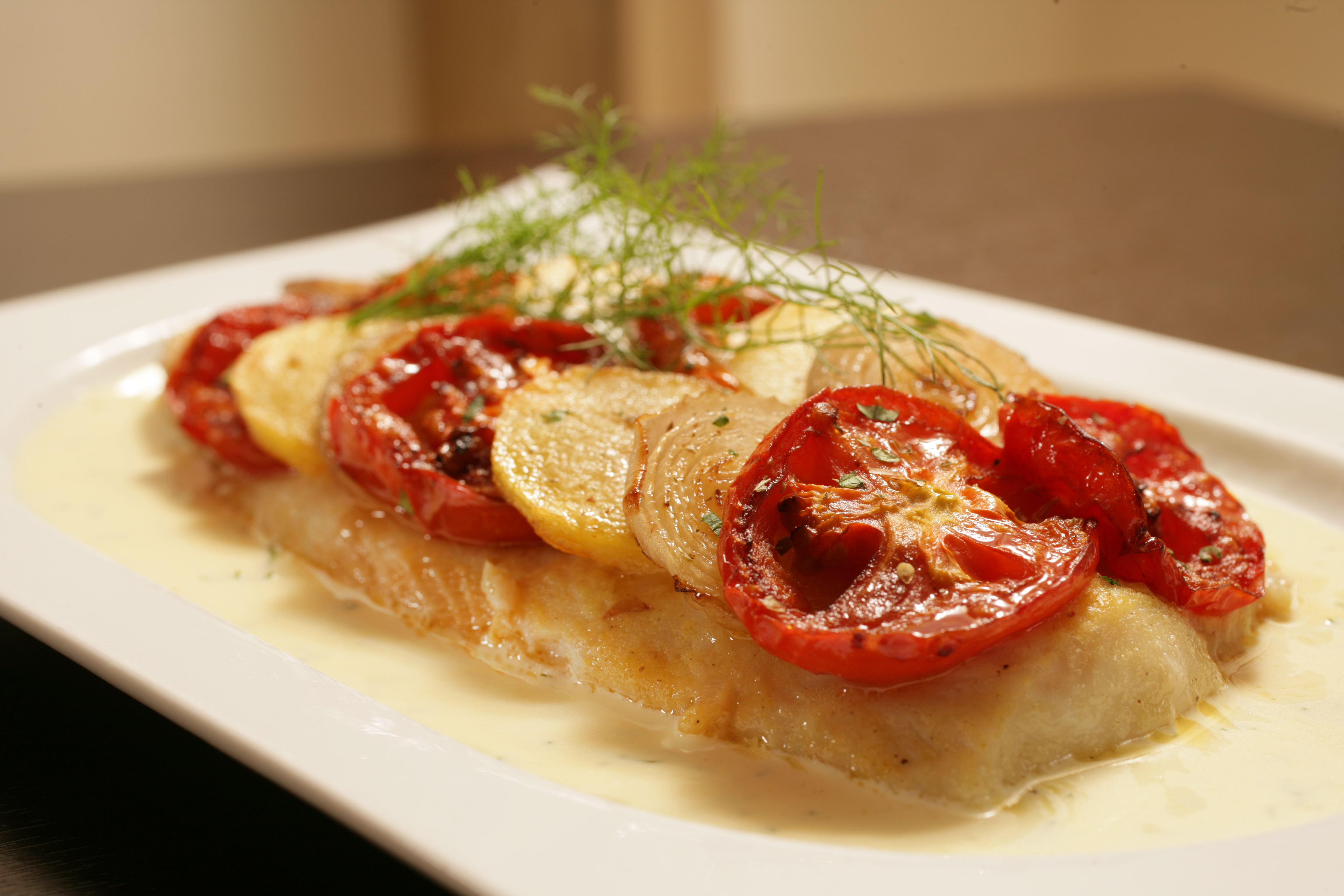 A cozy italian evening at luigi s four points by sheraton for Oven baked fish