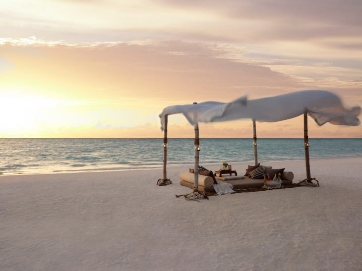 Dine by Design romantic set-up on the beach at sunset
